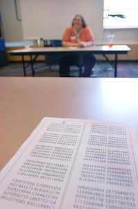 A judge's sheet with the number pi calculated out to more than 1,000 digits sits on a table before May Beth Everett attempts to recite as many digits as she can on Friday in Denton. <TypographyTag12>See video online at DentonRC.com.</TypographyTag12>David Minton