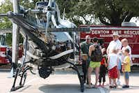 A Texas Department of Public Safety Eurocopter AS350B2 helicopter attracts a crowd during Denton Public Safety Day on Saturday at the Denton Civic Center.David Minton - DRC