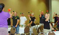 Tenor drum instructor Allie Guerrero teaches flourishing (spinning tenor mallets) to firemen at the Pipes and Drums Conference hosted by the Lewisville Fire Department at the Hilton Garden Inn in Lewisville Thursday May 9, 2013. Photo by Al Key/DRCAl Key