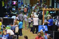 Crowds browse the Redbud Festival's vendor area inside the Denton Civic Center on Saturday.David Minton - DRC