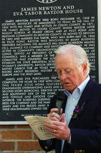 William R. Goff, great-grandson of James Newton and Eva Tabor Rayzor, reads the text of the Texas Historical Marker at his grandparents' former home at 1003 W. Oak St.David Minton - DRC