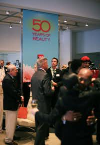 Guests mingle at Sally Beauty's 50th anniversary party on Wednesday at the company's headquarters.David Minton - DRC
