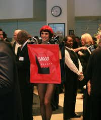 A model dressed as a Sally Beauty shopping bag walks around at the company's 50th anniversary party Wednesday.David Minton - DRC