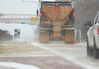 A City of Denton sand truck puts down sand on the hill on Bell Avenue that runs through TWU during the snowstorm Thursday morning.Al Key