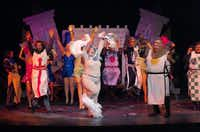 "The Lady of the Lake peps up the Knights of the Round Table with a Minnelli-like club number — complete with scatting, mugging and attitude. Music Theatre of Denton will end its run of ""Monty Python's Spamalot,"" this weekend. The musical skewers the legend of King Arthur and the Knights of the Round Table, based on the"" Monty Python and the Holy Grail."" <137>Music Theatre of Denton presents Spamalot, Tuesday, February 25, 2014, at the Campus Theatre in Denton, TX. David Minton/DRC<137>Photos by David Minton"