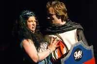 "The Lady of the Lake (Brynne Huffman) sings the duet ""The Song That Goes Like This"" with Sir Galahad (Sterling Gafford) in ""Month Python's Spamalot"" on Tuesday at The Campus Theatre in Denton. <137>Music Theatre of Denton will end its run of 'Monty Python's Spamalot,' this weekend. The musical skewers the legend of King Arthur and the Knights of the Round Table, based on the Monty Python film <italic>In Search of the Holy </italic>Grail.Music Theatre of Denton presents Spamalot, Tuesday, February 25, 2014, at the Campus Theatre in Denton, TX. David Minton/DRC<137>David Minton"