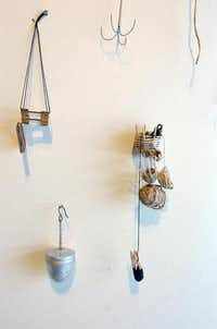 """Spoon Collection"" by Abby Sherrill uses found objects, wire and bits of paper and cardboard.Al Key"