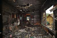 This interior shot shows the damage to one of the bedrooms inside the house on Egan Street.Al Key