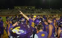 Sanger head coach Chuck Galbreath directs his team during their first practice just after midnight on Monday August 5, 2013, in Sanger.Al Key - DRC
