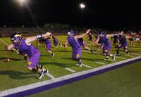 Sanger offensive linemen go through drills during the first practice of the season just after midnight Monday August 5, 2013, in Sanger.Al Key - DRC