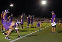 Sanger assistant coach Steve Ford works with the defensive line during their first day of practice for the 2013 season just a little after midnight Monday August 5, 2013, in Sanger, Tx.Al Key - DRC