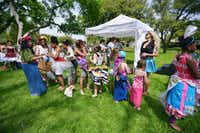 Participants line up to model garments made from recycled materials in the Trashion Show on Saturday at Quakertown Park.David Minton - DRC
