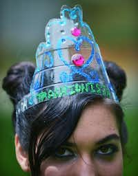 Carolina Carrasquillo, who entered her dress in Saturday's Trashion Show, wears her winner's tiara made from part of a two-liter soda bottle.David Minton - DRC