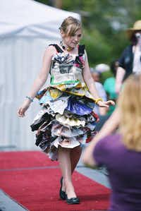 Megan Gibson, 11, created a dress from magazines and newspapers for the 2014 Trashion Show.David Minton - DRC