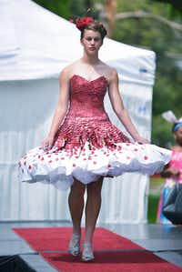 Abby Quick goes down the runway in a dress decorated with recycled Starbucks gift cards during the Trashion Show on Saturday at Quakertown Park.David Minton - DRC