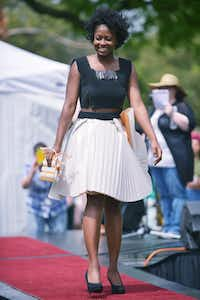 Esosa Osagiede heads down the runway in a dress with a skirt made from window shades during the Trashion Show at the Redbud Festival on Saturday.David Minton - DRC