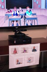 The Teach-LivE classroom computer simulation program, shown Wednesday, creates an interactive environment for education students to practice being in front of a class.David Minton