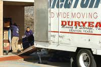 Employees of Duryea Moving & Storage unload furniture into the new United Way of Denton County office at 1314 Teasley Lane on Friday morning in Denton.Al Key - DRC