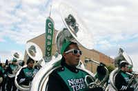 The Green Brigade marches down Hickory Street during the University of North Texas homecoming parade on Saturday morning.David Minton - DRC