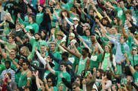 The student side of Apogee Stadium shows off their talons during the University of North Texas fight song in the first quarter of Saturday's game against the University of Texas at El Paso.David Minton - DRC