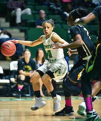 North Texas senior guard Kasiney Williams, left, dribbles the ball as Southern Mississippi junior Lashyra Cotton defends Saturday at the Super Pit.David Minton