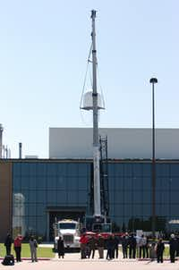 Workers lift the new CASA radar sensor onto the roof at the University of North Texas' Discovery Park on Thursday in Denton.David Minton - DRC