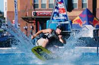 A wakeboarder lands in the splash pool at Saturday's Fry Street Wakepoolooza.David Minton - DRC