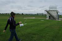 National Weather Service meteorologist Jamie Gudmestad carries a radiosonde out to a building where she will release a weather balloon at the NWS Dallas/Fort Worth, TX Weather Forecast Office, Tuesday, April 23, 2013, in Fort Worth, TX.David Minton - DRC