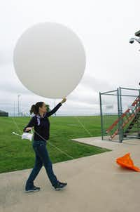 National Weather Service meteorologist Jamie Gudmestad prepares to release a weather balloon at the organization's office Tuesday in Fort Worth.David Minton - DRC