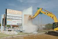 The sign at Golden Triangle Mall comes down after 33 years of service Friday morning August 2, 2013, in Denton.Al Key - DRC