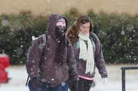 UNT students walk through the snow to morning classes on Highland Street Thursday.Al Key - DRC