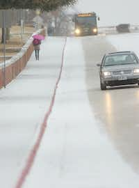 The hill on Bell Avenue near TWU was slick from the snow Thursday morning February 6, 2014, in Denton, Tx. Photo by Al Key/DRCAl Key