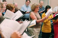 Members of the Denton Bach Choir concentrate as they sing Bach's Christmas Oratorio in a rehearsal Monday. The oratorio, which the Denton Bach Society will perform on Dec. 9, is rarely performed in its entirety in the United States and will pass the two-hour mark.DRC - David Minton
