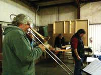 Trombonist Steve Wiest, left, practices during a rehearsal for last year's Denton Holiday Music Spectacular. Wiest, pictured here with fellow trombonist and bandleader of the Spectacular David Pierce, returns to the holiday stage next week.