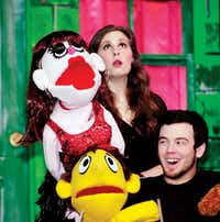 Actress/puppeteer Kelsey Macke, with Lucy, and actor/puppeteer Matt Purvis, with Princeton, rehearse Music Theatre of Denton's production of Avenue Q in February.DRC - Al Key