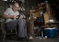 In this Sept. 22 photo, Ramiro Gonzalez assembles a boot at the Maida's Custom Footwear shop in Houston.Marie D. De Jesus