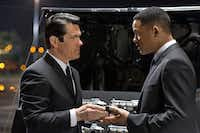 A younger Agent K (Josh Brolin, left) must team up with a time-traveling J (Will Smith) in Men in Black 3.Wilson Webb - Sony