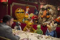 "Ricky Gervais, left, talks with Kermit and crew in a scene from ""Muppets Most Wanted.""Disney Enterprises Inc."