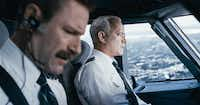 """Captain Sullenberger (Tom Hanks), right, and First Officer Skiles (Aaron Eckhart) must safely land a disabled plane in """"Sully.""""Warner Bros. Pictures"""