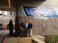 Argyle resident Kevin Faciane, left, and Chris Curtis of Flower Mound, right, are pictured with Kevin Saal, event manager for the University of Kentucky Wildcats, center, at Renaissance Dallas Hotel on Wednesday. Faciane and Curtis are the Final Four team hosts for the Wildcats this week.