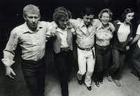 """A line of dancers steps to the """"Cotton-Eyed Joe"""" at the Double L Ballroom in the Green Valley community in 1979. The Lynch family built the dance hall off Green Valley Road, opening it on Saturday nights starting in 1974.DRC file photo"""