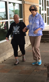 Elida Tamez, left, walks her 92-year-old mother in law, Violet Palmer, out of the City of Denton jail Tuesday morning. Mrs. Palmer, along with her son, Theron Palmer, were taken into custody Tuesday morning for blocking the entrance to the Vantage Energy gas well site in western Denton.Megan Gray-Hatfield - DRC