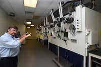 Ian Horn, radiation safety officer for NuView Life Sciences, shows what is called a hot cell, which shielded workers from the medical radioisotopes as they were being packaged.Al Key