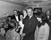 In this Nov. 22, 1963 photo from the White House via the John Fitzgerald Kennedy Library in Boston, Lyndon B. Johnson is sworn in as president as Jacqueline Kennedy stands at his side in the cabin of the presidential plane on the ground at Love Field in Dallas.Cecil Stoughton