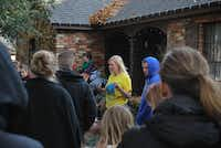 Sunshine Spaces Erica Jones speaks with volunteers outside the Perry family's home moments before the family arrives on Sunday.John D. Harden