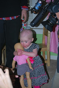 Two-year-old Brielle Perry embraces a new doll that was made to resemble her. Perry was born in September 2011, with Down syndrome and a heart defect. In April, she was diagnosed with leukemia and six rounds of chemotherapy followed, which she recently completed.John D. Harden