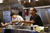 Andres Meraz, right, just opened Boca 31 at 207 S. Bell Ave. in Denton. Meraz, who worked as a chef at several high-profile restaurants around the world, is pictured Friday at his eatery.Photos by David Minton