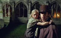 Jean Valjean (Hugh Jackman) becomes the guardian of young Cosette (Isabelle Allen) in Les Miserables.Universal Studios