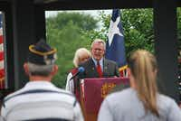 Purple Heart recipient Virgil Aldag speaks to a crowd of people about the importance of remembering fallen soldiers.John D. Harden - DRC