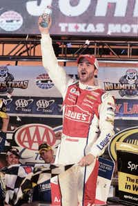 Jimmie Johnson celebrates winning the NASCAR Sprint Cup Series auto race at Texas Motor Speedway in Fort Worth<137>, Texas,<137> on Sunday<137>, Nov. 2, 2014<137>.<137> (AP Photo/Larry Papke)<137>Larry Papke